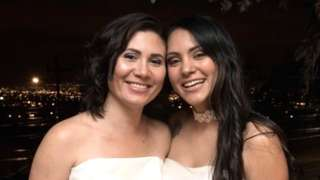 Newlyweds Alexandra Quiros (L) and Dunia Araya (R) pose during their wedding in Heredia, Costa Rica, on May 26, 2020