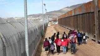 Central American immigrants cross the Rio Grande from Mexico into n El Paso, Texas, 1 February 2019