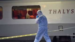 Police walk on a platform next to a Thalys train after the shooting