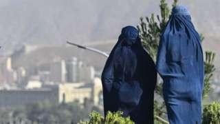 Two women wearing burqas