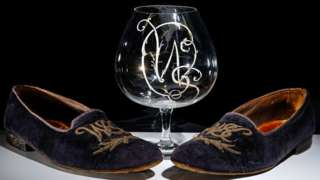 The slippers and the brandy glass