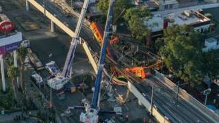 An aerial view shows the site of a metro train accident after an overpass for a metro partially collapsed in Mexico City