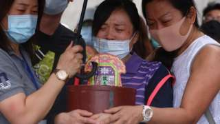 Relatives of the victims grieve near the site of the deadly accident, a day after a train derailed at a tunnel north of Hualien, Taiwan April 3, 2021