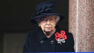 The Queen watching the service