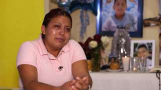 Marisol Tapia sits in front of an altar she has erected for her son Brandon