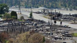 The charred remnants of homes and buildings, destroyed by a wildfire on June 30, are seen during a media tour by authorities in Lytton, British Columbia, Canada July 9, 2021.