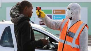 Informal traders temperature is checked at the gate of Cape Town Market on Day Five of National Lockdown on March 31, 2020 in Cape Town, South Africa
