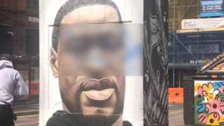George Floyd mural with offensive word blurred