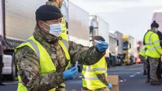 Military personnel helping test lorry drivers for Covid-19
