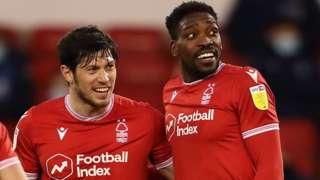 Scott McKenna and Sammy Ameobi celebrate a goal against Millwall