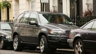 SUV car parked on a London street.