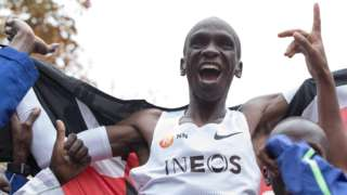 Eliud Kipchoge celebrates breaking the two-hour marathon barrier as he is held up on supporters' shoulders