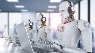 robots at laptops