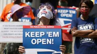 People protest in support of the US Postal Service in New York on Monday
