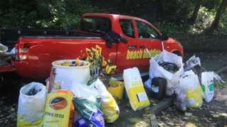 Beach Buddies truck with bags of litter