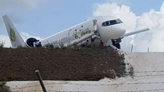 A Toronto-bound Fly Jamaica airplane is seen after crash-landing at the Cheddi Jagan International Airport in Georgetown, Guyana on November 9, 2018. -