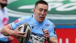 Blues' Josh Adams heads for the line against Dragons