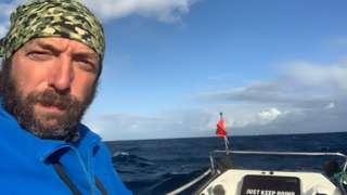 Andrew Baker on the boat