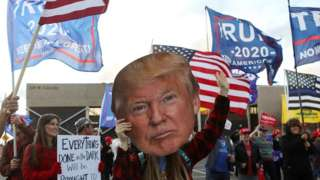 Trump face held by protester