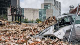 A car is seen under rubble after a building was destroyed by Hurricane Ida on August 30, 2021 in New Orleans, Louisiana
