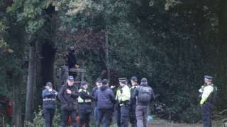 Police and security teams moved in to remove protestors from woodland in Buckinghamshire.