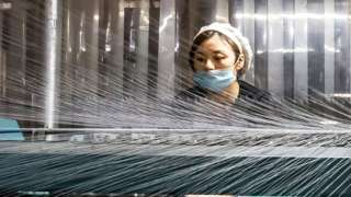 A woman working in a textile factory in Nantong in China's eastern Jiangsu province