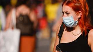 Woman on the street wearing a facemask
