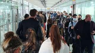 Passengers queue a Heathrow