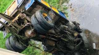Truck wey dem dey comot from water