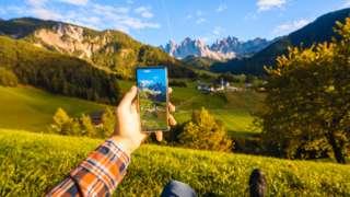Nature viewed through a smartphone screen