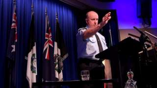 Australian Federal Police acting commissioner Neil Gaughan speaking at a press conference
