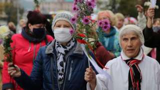 Belarusian pensioners march during a pensioners rally to protest against the results of presidential elections in Minsk, Belarus, 12 October 2020.