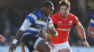 Semesa Rokoduguni of Bath bursts past the challenge of Vincent Koch of Saracens