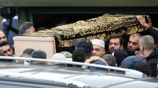 The coffin of Yassar Yaqub is carried outside Masjid Bilal Huddersfield