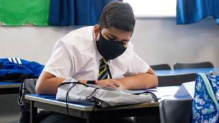 A child at school wearing a mask