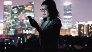 Women looks at phone