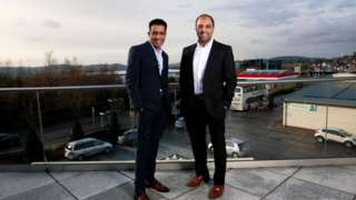 Mohsin and Zuber Issa pose on a balcony in Blackburn