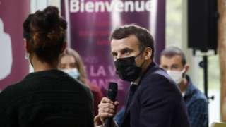 French President Emmanuel Macron meets with students