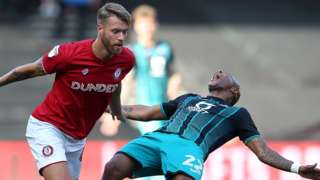 Andre Ayew goes down from a challenge by Nathan Baker
