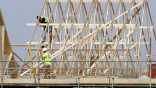 builders at work on new homes