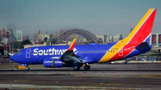 A Southwest Airlines passenger jet lands at LaGuardia Airport in New York
