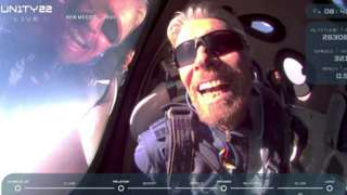 """Billionaire Richard Branson reacts on board Virgin Galactic""""s passenger rocket plane VSS Unity after reaching the edge of space above Spaceport America near Truth or Consequences, New Mexico, U.S. July 11, 2021"""