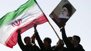Iranians hold national flag and a picture of Ayatollah Khamenei (file photo)