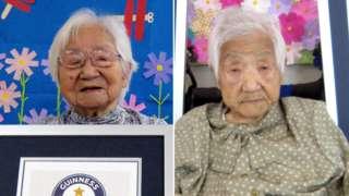 Umeno Sumiyama (L) and Koume Kodama with their official certificates