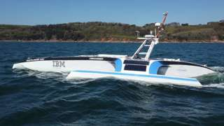 The autonomous Mayflower 400 sailing in water near Plymouth