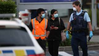 Police escort people from LynnMall to their cars after a violent extremist took out a terrorist attack stabbing six people before being shot by police on September 03, 2021 in Auckland, New Zealand