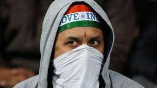 An India fan in a mask
