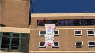Put students and staff before profits banner