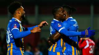 Fejiri Okenabirhie of Shrewsbury Town celebrates