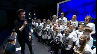 Rick Astley and pupils from Netherfield Primary School
